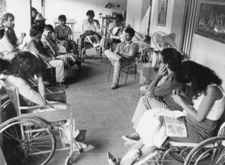 disabled people sitting in a circle having a meeting