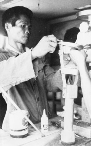 Boy building a prosthetic.