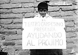 ALT=child holding up a sign