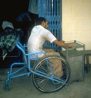 Man in wheelchair making furniture.
