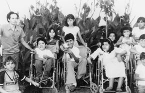Group of boys and girls in wheelchairs and standing.