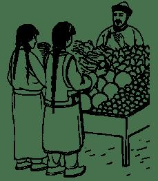 2 women examine produce on a table as a vendor smiles.