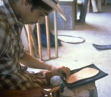 man making a sandal