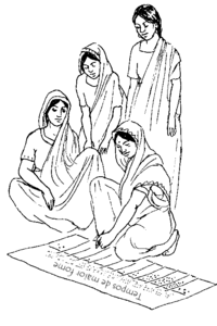 "Women in saris look over a chart labelled ""Times of greater hunger."""