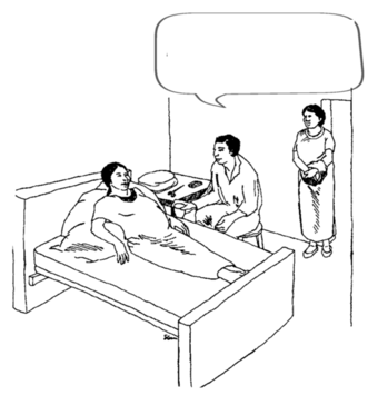 babaeng nagsasalita habang may buntis na babaeng nakahiga sa kama at may lalaking nakaupo nang malapit