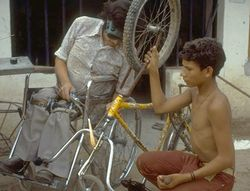 a disabled man fixing a bicycle