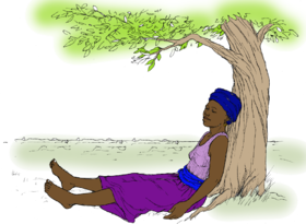 Person relaxing under a tree.