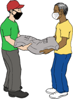Two masked workers together carrying a large, heavy sack.